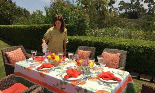 Chef Jodi preparing a table outside